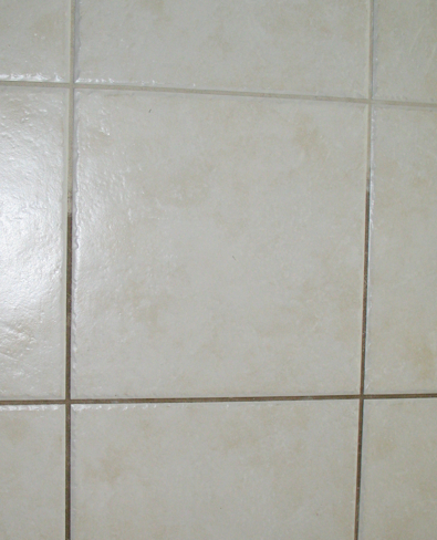 Presto!  Grout goes from black to white in the blink of an eye.